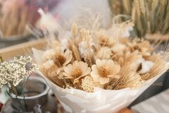 Bouquet of dried flowers. Still life with wheat ears and yellow wildflowers. stock photo