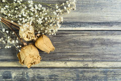 Bouquet of the dried flowers with three white roses Royalty Free Stock Image