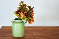 Bouquet of dried flowers in vase on table and light background. A bouquet of dried flowers in a vase. Dry flowers royalty free stock images