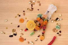 Colorful dried fruits for the Jewish holiday of Tu Bishvat. Bouquet of dried fruits in a vase on a wooden table background for the Jewish holiday of Tu BiShvat stock image