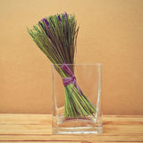 Bouquet of dried lavender flowers in a glass vase Stock Photography