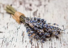 Bouquet of dried lavender. On the old table Stock Photography