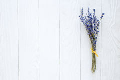 Bouquet of dried lavender on wooden table top view Stock Photos