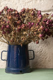 Bouquet of dried roses in blue jug Stock Photography