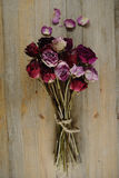 Bouquet of dried roses on a wooden Royalty Free Stock Photos