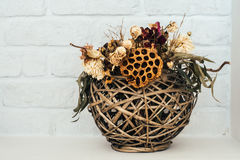 Bouquet of dried wild flowers on white briсk background. Royalty Free Stock Photography