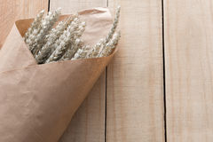 Bouquet dry grass on wooden Royalty Free Stock Photography