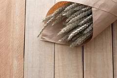 Bouquet dry grass on wooden Stock Photos