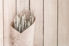 Bouquet dry grass on wooden Royalty Free Stock Photo