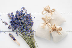 Bouquet of dry lavender flowers and sachets filled with lavender Royalty Free Stock Photography