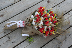 A bouquet of ears of corn and chocolates decorated in the form o Stock Photography
