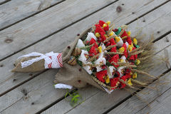 A bouquet of ears of corn and chocolates decorated in the form o Stock Image