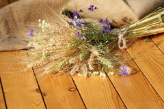 Bouquet of ears of rye and wildflowers Stock Photo