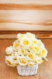 Bouquet of ecru roses in wicker basket Stock Photography