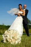 Bouquet et couples de mariage images stock