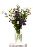 Bouquet of eustoma flowers in vases over white Stock Image
