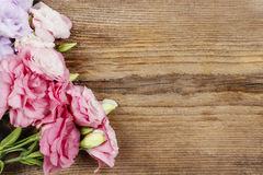 Bouquet of eustoma flowers on wooden table. Stock Photo