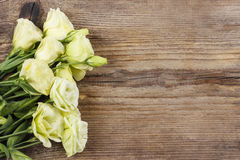 Bouquet of eustoma flowers on wooden table. Royalty Free Stock Photos