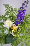 Bouquet of fern, peonies, delphinium Royalty Free Stock Photos