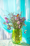 A bouquet of field dry flowers in a vase Stock Photography