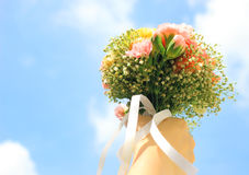 Bouquet of flower in hand and sky Stock Photo