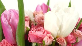 Bouquet flower with roses and tulips, on white, rotation, close up. Bouquet flower with roses and tulips, on white background, rotation, close up stock footage