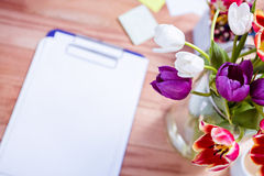 Bouquet of flower in a vase on the desk Stock Image