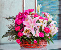Bouquet of flower in wicker basket Royalty Free Stock Photos