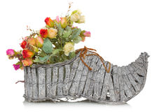 Bouquet of flower in wooden boot on a white background Stock Photo