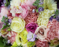 Bouquet of flowers. Bouquet of mixed yellow, pink, peach and purple flowers Stock Image