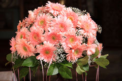 Bouquet of flowers. Bouquet of pink flowers on a stand decorate a church Royalty Free Stock Photography