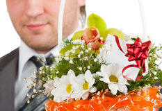Bouquet of flowers against happy groom Royalty Free Stock Image