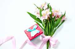 Bouquet of flowers alstroemeria with gift box on a white background. Royalty Free Stock Images