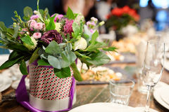 A bouquet of flowers at the banquet table. In a restaurant Royalty Free Stock Photos
