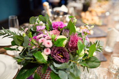 A bouquet of flowers at the banquet table. In a restaurant Royalty Free Stock Photo