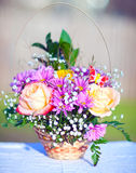 Bouquet of flowers in a basket Stock Images