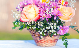 Bouquet of flowers in a basket Stock Photos