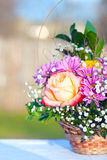 Bouquet of flowers in a basket Royalty Free Stock Photography