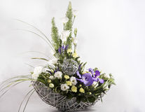 Bouquet of flowers in a basket. Floristic composition of  beautiful flowers Stock Image