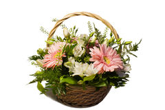 A bouquet of flowers in a basket. Bouquet of pink and white flowers in basket on white background Royalty Free Stock Photos