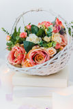 Bouquet of flowers in a basket, Wedding decoration, hand made. Royalty Free Stock Photo