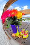 Bouquet of flowers by beach Royalty Free Stock Image
