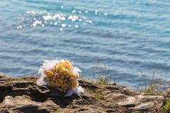 Bouquet of flowers on the beach Royalty Free Stock Image