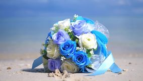 Bouquet flowers on the beach white sand tropical paradise island on sea water ocean background and cloudy sky changes. Bouquet flowers on the beach white sand stock video