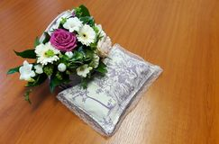 Flowers bouquet and a laveder pillow royalty free stock photo