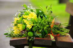 Bouquet of flowers on a bench Royalty Free Stock Images