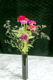 Bouquet of flowers in black vase Stock Photography