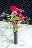 Bouquet of flowers in black vase Stock Photo