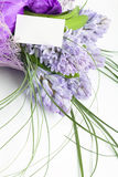 Bouquet of flowers with blank white card. Beautiful bouquet of flowers with blank white card to put your message Royalty Free Stock Photos