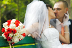 Bouquet of flowers with blurred newlyweds Stock Image